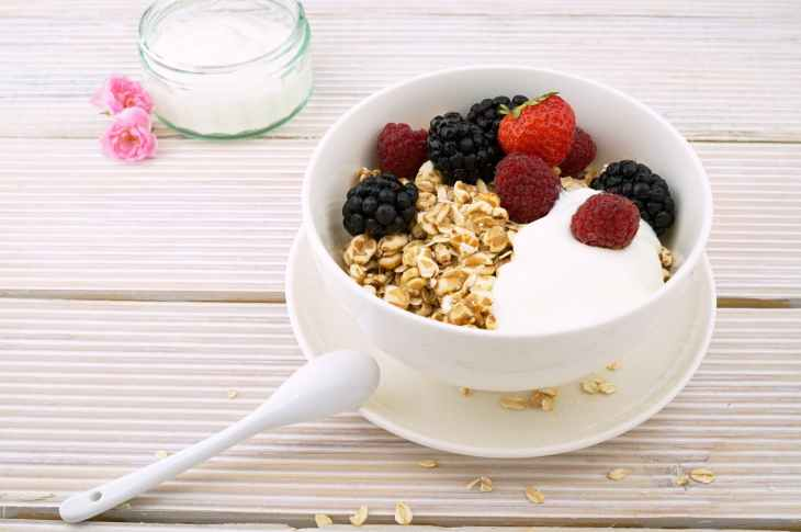 cereals cream strawberry blackberry and raspberry filled white ceramic bowl